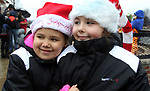 TORRINGTON CT. 23 December 2017-122217SV03-Faith Mason, 6, and Shilo Valentin, 8, of Naugatuck try to stay warm while waiting in line to see Santa at the Christmas Village in Torrington Saturday.<br />  Steven Valenti Republican-American