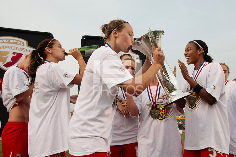 Whitney Engen (23) of the Western New York Flash sips champagne from the championship trophy. The Western New York Flash defeated the Philadelphia Independence 5-4 on penalty kicks after overtime following a 1-1 tie in the Women's Professional Soccer (WPS) Championship game at Sahlen's Stadium in Rochester, NY August 27, 2011.