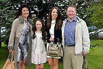 Lauren Finglas pictured after her confirmation at Holy Family Church, Ballsgrove on Saturday with her parents Shane and Michelle and sister Kelsey. Photo: Andy Spearman. www.newsfile.ie