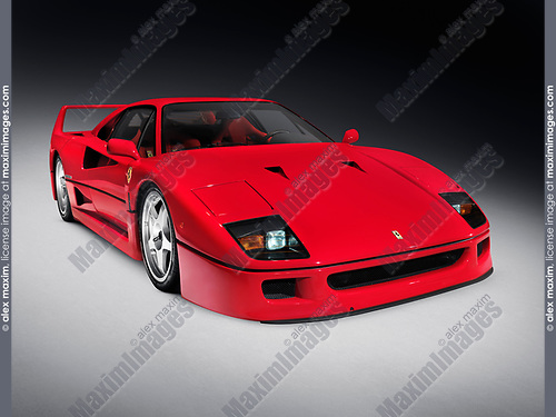 Red 1987 Ferrari F40 iconic sportscar isolated on dark gray background with clipping path