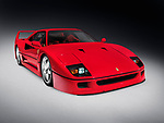 Red 1987 Ferrari F40 iconic sportscar isolated on dark gray background with clipping path Image © MaximImages, License at https://www.maximimages.com