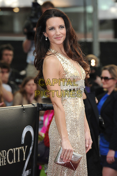 KRISTIN DAVIS in Norman Norell.'Sex And The City 2' European Premiere at the Odeon, Leicester Square, London, England..May 27th, 2010.half length gold sequined sequins beaded beads sleeveless dress gown clutch bag gem encrusted jewel side embellished metallic halterneck .CAP/BEL.©Tom Belcher/Capital Pictures.