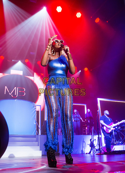 MIAMI BEACH, FL - AUGUST 22: Mary J. Blige performs during The Strength of a Woman Tour at Fillmore Miami Beach in Miami Beach. August 22, 2017. <br /> CAP/MPI/AAG<br /> &copy;AAG/MPICapital Pictures