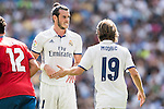 Gareth Bale of Real Madrid reacts with teammate Luka Modric during the La Liga match between Real Madrid and Osasuna at the Santiago Bernabeu Stadium on 10 September 2016 in Madrid, Spain. Photo by Diego Gonzalez Souto / Power Sport Images