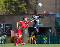 Aaron Pierre of Wycombe Wanderers wins a header from Reece Thompson during the Sky Bet League 2 match between Wycombe Wanderers and York City at Adams Park, High Wycombe, England on 8 August 2015. Photo by Andy Rowland.