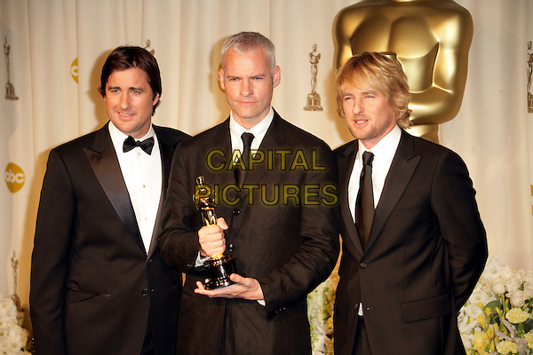 LUKE WILSON, MARTIN McDONAGH & OWEN WILSON.The 78th Annual Academy Awards - Press Room, held at the Kodak Theatre, Los Angeles, California, USA. .March 5th, 2006.Photo: Russ Elliot/Admedia/Capital Pictures.Ref: RE/ADM.Oscar Oscars half length award trophy black suit tuxedo.www.capitalpictures.com.sales@capitalpictures.com.© Capital Pictures.