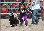 Piper Colburn, 7, of Fallon, competes in a chicken race at the 56th annual International Camel &amp; Ostrich Races in Virginia City, Nev. on Friday, Sept. 11, 2015. <br /> Photo by Cathleen Allison