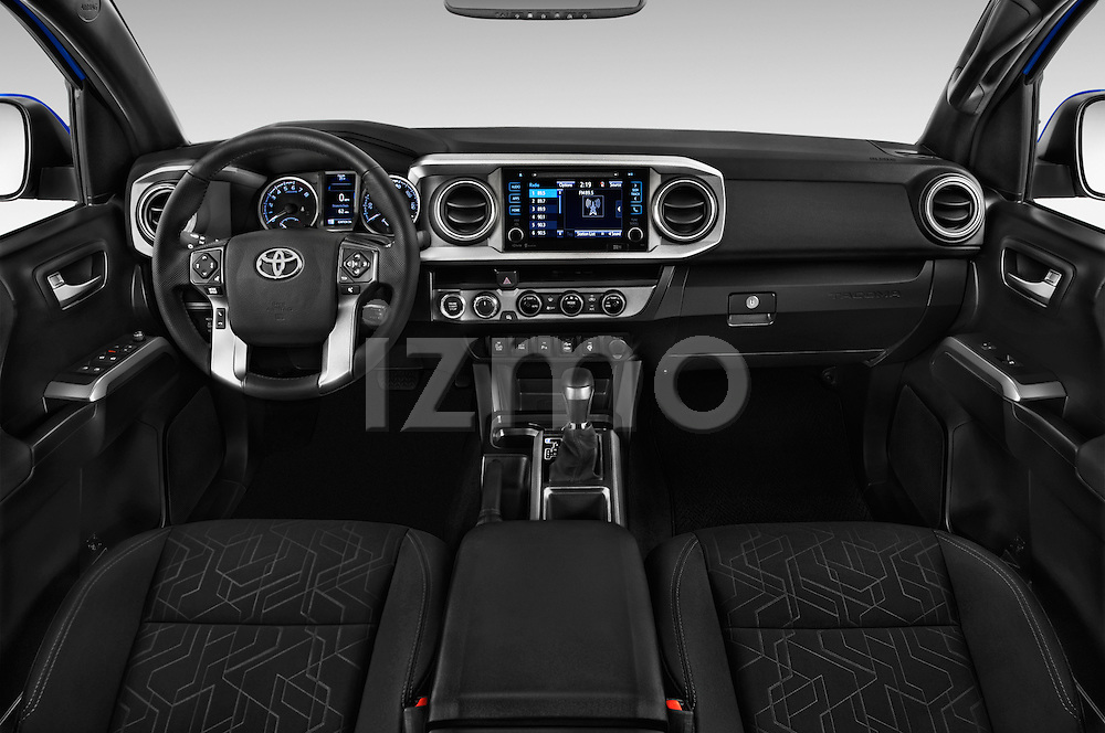 Stock photo of straight dashboard view of 2016 Toyota Tacoma TRD Sport 4 Door Pickup Dashboard