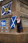 An anti-independence protester with a megaphone at a pro-independence gathering in George Square, Glasgow. The gathering brought together Yes Scotland supporters who favour Scotland leaving the union with the United Kingdom. On the 18th of September 2014, the people of Scotland voted in a referendum to decide whether the country's union with England should continue or Scotland should become an independent nation once again and leave the United Kingdom.