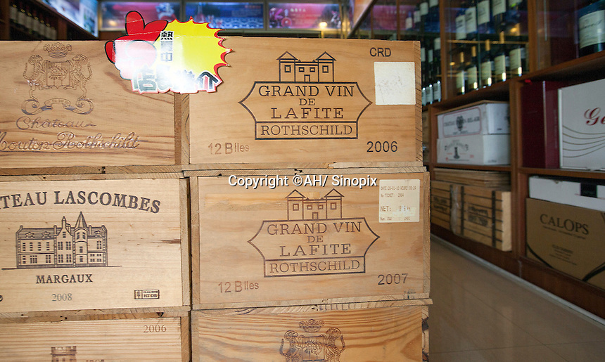 Purportedly French crates of Lafite wine are seen in a shop that sells real and fake wine, Guangzhou, Guangdong Province, China, 18 July 2014. <br /> <br /> PHOTO BY SINOPIX