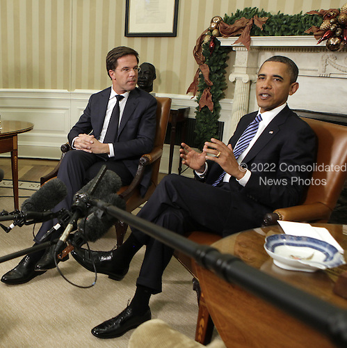 United States President Barack Obama, right, and Prime Minister Mark Rutte, left, of the Netherlands make remarks to the press in the Oval Office of the White House in Washington, DC on Tuesday, November 29, 2011. .Credit: Yuri Gripas / Pool via CNP