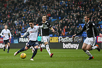 Bolton Wanderers' Zach Clough shoots at goal as Fulham's Tim Ream runs out to block<br /> <br /> Photographer Andrew Kearns/CameraSport<br /> <br /> The EFL Sky Bet Championship - Bolton Wanderers v Fulham - Saturday 10th February 2018 - Macron Stadium - Bolton<br /> <br /> World Copyright &copy; 2018 CameraSport. All rights reserved. 43 Linden Ave. Countesthorpe. Leicester. England. LE8 5PG - Tel: +44 (0) 116 277 4147 - admin@camerasport.com - www.camerasport.com
