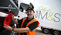 30/09/14 <br /> <br /> ***FREE PHOTO FOR EDITORIAL USE***<br /> <br /> Proudly wearing his submariner's cap badge, ex Petty Officer, and current Marks and Spencer's employee, Roddy Warren (54) places the first poppy on the front of a Marks and Spencer lorry at the company's distribution centre in Castle Donington, Derbyshire. <br /> <br /> Poppies will be placed on ??1500?? Marks and Spencer delivery vehicles marking their continued support for the Royal British Legion's poppy appeal on the one hundredth anniversary year of the start of the First World War.<br /> <br /> All Rights Reserved: F Stop Press Ltd. +44(0)1335 300098   www.fstoppress.com.