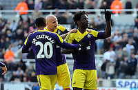 Pictured: Wilfried Bony of Swansea (R) celebrating his goal with team mates L-R Jonathan de Guzman and Jonjo Shelvey, he scored from the penalty spot after Marvin Emnes was brought dowin in the box in stoppage time. Saturday 19 April 2014<br /> Re: Barclay's Premier League, Newcastle United v Swansea City FC at St James Park, Newcastle, UK.