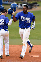 Catcher Cole Jackson (35) of the Spartanburg Methodist College Pioneers is congratulated after hitting a home run in Game 2 of a junior college doubleheader against Southeastern Community College on Wednesday, March 28, 2018, at Mooneyham Field in Spartanburg, South Carolina. (Tom Priddy/Four Seam Images)