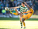 CELTIC'S ADAM MATTHEWS AND MOTHERWELL'S CHRIS HUMPHREY CHALLENGE FOR THE BALL