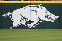 Arkansas Razorbacks logo on the outfield wall at Baum Stadium during the NCAA baseball game against the against the Alabama Crimson Tide on March 21, 2014 in Fayetteville, Arkansas.  The Alabama Crimson Tide defeated the Arkansas Razorbacks 17-9.  (William Purnell/Four Seam Images)