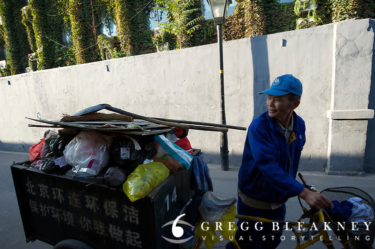 In downtown Beijing's maze of alleyway streets called Hutongs, garbage is collected with garbage-collecting bicycles.  2011 Tour of Beijing