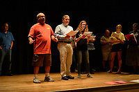 "NWA Democrat-Gazette/ANDY SHUPE<br /> Flip Putthoff (from left), Greg Harton and Mary Hennigan sing Wednesday, Sept. 18, 2019, as they rehearse a scene for ""Gridiron"" in Giffels Auditorium in Old Main on the University of Arkansas campus in Fayetteville."