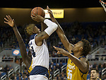Nevada forward Jordan Caroline (24 takes a shot against California Baptist in the first half of an NCAA college basketball game in Reno, Nev., Friday, Nov. 16, 2018. (AP Photo/Tom R. Smedes)