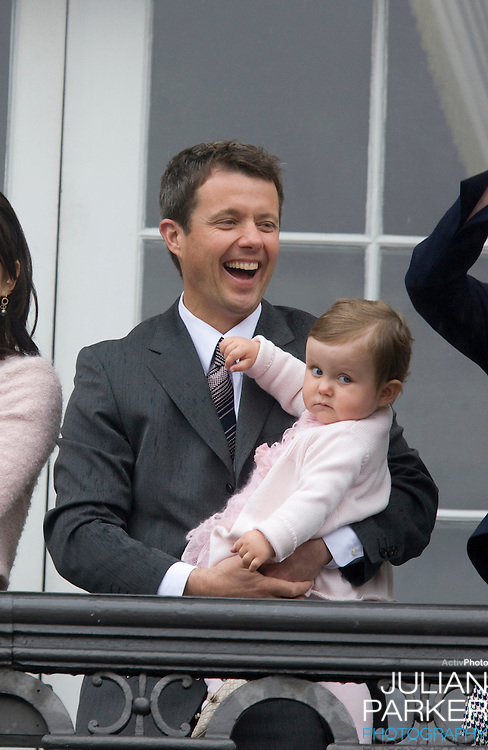 Crown Prince Frederick and his daughter Princess Isabella on the Balcony of Amalienborg Palace in Copenhagen to celebrate Crown Prince Frederik's 40th Birthday.
