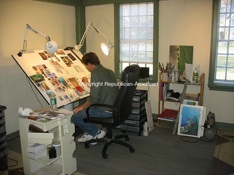 WOODBURY, CT - 9 November 2010 - 110910RH01 - Artist Robert Crawford works in his new studio at the former home of Wayne Pratt Antiques on Main Street South in Woodbury. A trio of tenants have rented space in the historic home, still for sale. Rick Harrison Republican-American