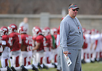 NWA Media/ANDY SHUPE - Arkansas coach Bret Bielema watches during practice Saturday, Dec. 13, 2014, at the university's practice facility in Fayetteville.