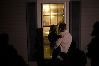 People try to get a glimpse of former Utah governor Jon Huntsman at a house party in Bedford, New Hampshire, on Jan. 8, 2012. Huntsman is seeking the 2012 Republican presidential nomination.