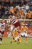 FC Dallas forward Carlos Ruiz (20) goes up for the header.  Houston Dynamo defeated FC Dallas 4-1 at Robertson Stadium in Houston, TX on November 2, 2007.  Houston Dynamo won the Western Conference semifinal series with an aggregate score of 4-2.