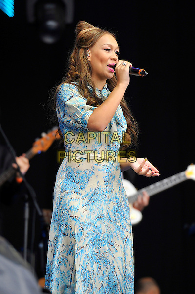 Rebecca Ferguson.Performing at BT London Live, Hyde Park, London, England. .31st July 2012.on stage in concert live gig performance half length blue white print dress singing belt profile .CAP/MAR.© Martin Harris/Capital Pictures.