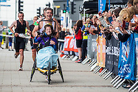 COPY BY TOM BEDFORD<br /> Sunday 26 June 2016<br /> Pictured: Poppy and dad Rob cross the finish line  in Cardiff Bay <br /> Re: A very special father-and-daughter team have tackled the Cardiff Triathlon.<br /> Poppy Jones, 11, who will be competing alongside dad Rob Jones, wants to win the event.<br /> And she's not going to let the fact that she has quadriplegic cerebral palsy , which means she can't sit, stand, roll or support herself, and chronic lung disease stop her.<br /> She will be by Rob's side every step of the way thanks to a cutting-edge wheelchair and boat – for Rob to push or pull – designed especially for the event, which sees participants take part in a swim across Cardiff Bay , a run and a bike ride.