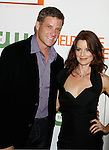 "LOS ANGELES, CA. - August 22: Laura Leighton (R) and Doug Savant arrive at the ""Melrose Place"" Los Angeles Premiere Party on August 22, 2009 in Los Angeles, California."