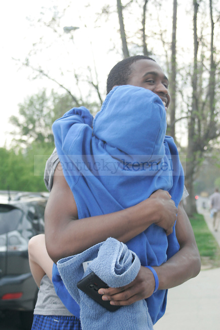UK guard Doron Lamb hugs a young fan before leaving for New Orleans for the Final Four game in Lexington, Ky. on March 28, 2012. Photo by Quianna Lige | Staff