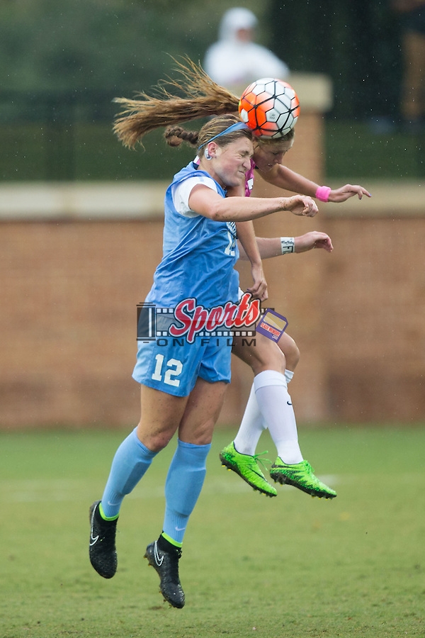 Jessie Scarpa (12) of the North Carolina Tar Heels battles for a jump ball against Sarah Teegarden (7) of the Wake Forest Demon Deacons during first half action at Spry Soccer Stadium on September 27, 2015 in Winston-Salem, North Carolina.  The Tar Heels defeated the Demon Deacons 1-0.  (Brian Westerholt/Sports On Film)