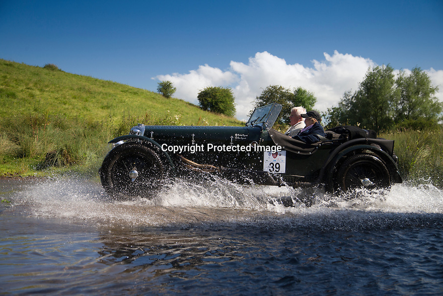 14/06/16<br /> <br /> Richard and Jane Jeffcoate in a 1938 Riley 16/4 Special.<br /> <br /> Competitors in the Royal Automobile Club 1000 Mile Trial splash through Tissington Ford near Ashbourne in the Derbyshire Peak District. The rally saw 43 pre-war cars leave Edinburgh on Monday and finishes in Dorking, Surrey on Saturday.<br /> All Rights Reserved, F Stop Press Ltd.