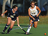 Sarah Whelan #19 of Massapequa, right, and Daniella Specht #14 of Baldwin battle for a loose ball during a Nassau County Conference I varsity field hockey match at Field of Dreams Park in Massapequa on Monday, Sept. 26, 2016. Whelan scored two goals in Massapequa's 5-0 win.