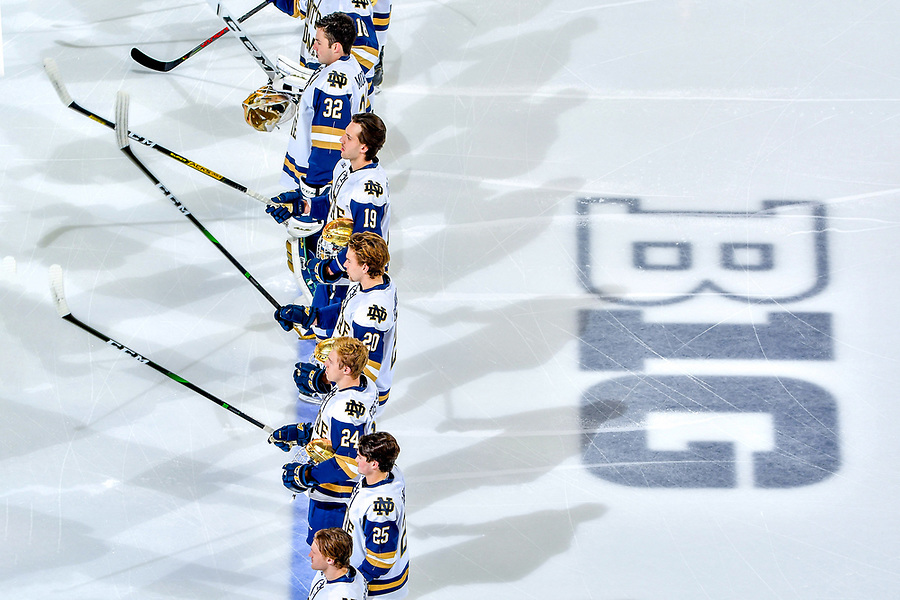 November 8, 2019; Hockey players stand for the national anthem before a game at Compton Family Ice Arena. (Photo by Matt Cashore)
