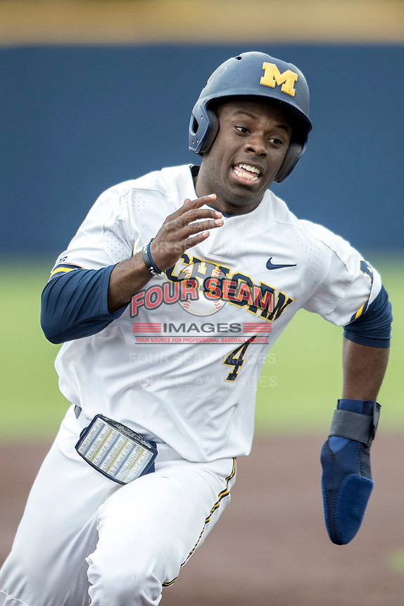 Michigan Wolverines second baseman Ako Thomas (4) rounds third base against the Maryland Terrapins on April 13, 2018 in a Big Ten NCAA baseball game at Ray Fisher Stadium in Ann Arbor, Michigan. Michigan defeated Maryland 10-4. (Andrew Woolley/Four Seam Images)