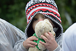 Mahdi, an 18-month old refugee from Iraq, holds a stuffed bear as she approaches the border into Croatia near the Serbian village of Berkasovo. Hundreds of thousands of refugees and migrants from Syria, Iraq and other countries have flowed through Serbia in 2015, on their way to western Europe. <br /> <br /> Parental consent obtained.