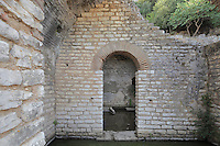 The Asclepian Treasury, built to hold offerings made to the god Asclepius, at the Shrine of Asclepius, Butrint, Chaonia, Albania. The earliest Sanctuary comprised a temple to the God, a stoa (covered walkway) and a treasury. By the 3rd century BC the Sanctuary had been modified to include a theatre and a perisytyle building, probably a pilgrim's hostel. Butrint was founded by the Greek Chaonian tribe and was a port throughout Hellenistic and Roman times, when it was known as Buthrotum. It was ruled by the Byzantines and the Venetians and finally abandoned in the Middle Ages. The ruins at Butrint were listed as a UNESCO World Heritage Site in 1992. Picture by Manuel Cohen
