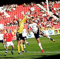Norwegian goalie, Erika Skarb¯ (1) reaches for the ball over Natasha Kai (6). USA 4,  Norway 0, Fredrikstad Stadium, July 2, 2008.