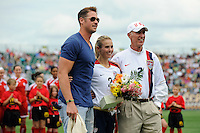 Heather Mitts (2) of the United States (USA) poses for a photo with fiance A. J. Feeley and father Don Mitts. The United States (USA) Women's National Team defeated Canada (CAN) 1-0 during an international friendly at Marina Auto Stadium in Rochester, NY, on July 19, 2009.