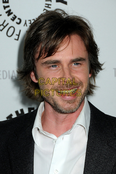 "SAM TRAMMELL.The 26th Annual William S. Paley Television Festival presents ""True Blood"" held at Arclight Cinemas, Hollywood, California, USA..April 13th, 2009.headshot portrait stubble facial hair mouth open .CAP/ADM/BP.©Byron Purvis/AdMedia/Capital Pictures."