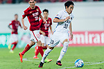 Kashima Midfielder Mu Kanazaki in action during the AFC Champions League 2017 Round of 16 match between Guangzhou Evergrande FC (CHN) vs Kashima Antlers (JPN) at the Tianhe Stadium on 23 May 2017 in Guangzhou, China. (Photo by Power Sport Images/Getty Images)