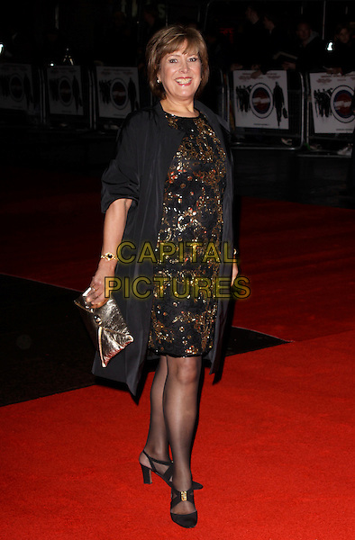 LYNDA BELLINGHAM.attending the European Premiere of 'Harry Brown' at the Odeon Leicester Square, London, England, UK, November 10th 2009. .full length black dress gold pattern coat tights shoes clutch bag.CAP/AH.©Adam Houghton/Capital Pictures.