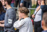 """Schuelerstreik und Demonstration """"Fridays4Future"""" (#f4f) in Berlin.<br /> Ca. 2.000 Menschen, hauptsaechlich Schuelerinnen und Schueler versammelten sich am Freitag den 19. Juli 2019 in Berlin mit ihrer woechentlichen Klimademonstration vor dem Wirtschaftsministerium in Berlin. Sie protestieren gegen die Klimapolitik der Wirtschaft und der Bundesregierung und fordern die Einhaltung der """"Pariser Klimaziele"""", die eine Begrenzung der Erderwaermung auf 1,5°C vorsieht.<br /> Als Gast sprach die schwedische Klimaschutzaktivistin Greta Thunberg, die mit ihrem individuellen Schulstreik die """"Fridays for Future"""" ausgeloest hat.<br /> Im Bild: Clara Mayer, Fridays 4 Future, sehr bewegt nach ihrer Rede.<br /> 19.7.2019, Berlin<br /> Copyright: Christian-Ditsch.de<br /> [Inhaltsveraendernde Manipulation des Fotos nur nach ausdruecklicher Genehmigung des Fotografen. Vereinbarungen ueber Abtretung von Persoenlichkeitsrechten/Model Release der abgebildeten Person/Personen liegen nicht vor. NO MODEL RELEASE! Nur fuer Redaktionelle Zwecke. Don't publish without copyright Christian-Ditsch.de, Veroeffentlichung nur mit Fotografennennung, sowie gegen Honorar, MwSt. und Beleg. Konto: I N G - D i B a, IBAN DE58500105175400192269, BIC INGDDEFFXXX, Kontakt: post@christian-ditsch.de<br /> Bei der Bearbeitung der Dateiinformationen darf die Urheberkennzeichnung in den EXIF- und  IPTC-Daten nicht entfernt werden, diese sind in digitalen Medien nach §95c UrhG rechtlich geschuetzt. Der Urhebervermerk wird gemaess §13 UrhG verlangt.]"""