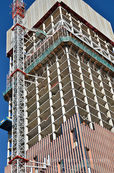 Close up of an office building tower under construction showing core and cladding.