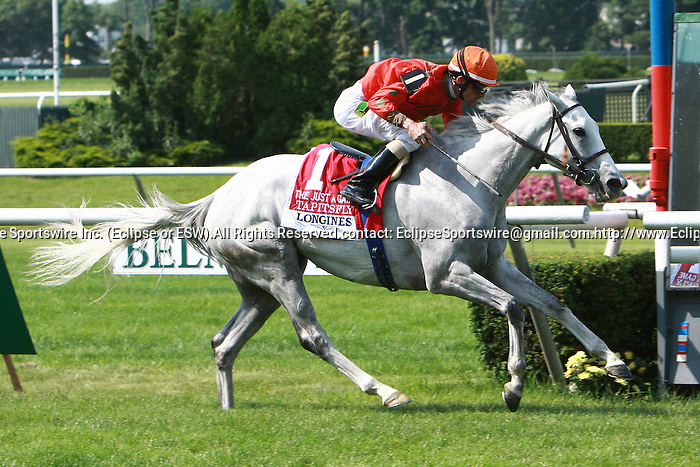 Tapitsfly with Ramon Dominguez win the 19th running of the Just A Game Stakes for fillies & mares, 3-year old and up, going 1 mile on the Widner turf at Belmont.  Trainer Dale Romans.  Owner Frank L. Jones Jr.