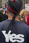 A man wearing a Scottish Glengarry hat with a 'Yes' slogan on his back at a pro-independence gathering in George Square, Glasgow. The gathering brought together Yes Scotland supporters who favour Scotland leaving the union with the United Kingdom. On the 18th of September 2014, the people of Scotland voted in a referendum to decide whether the country's union with England should continue or Scotland should become an independent nation once again and leave the United Kingdom.