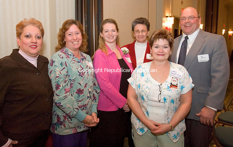 WATERBURY, CT- 19 DEC 07- 121907JS20- Migdalia Cruz, Karen Woods, Heather Rodriguez, Linda Ball, Eileen Knauf-Coon and Ron Bourque at the annual Easter Seals meeting and awards ceremony held at he Courtyard by Marriott in Waterbury. <br /> Jim Shannon/Republican-American